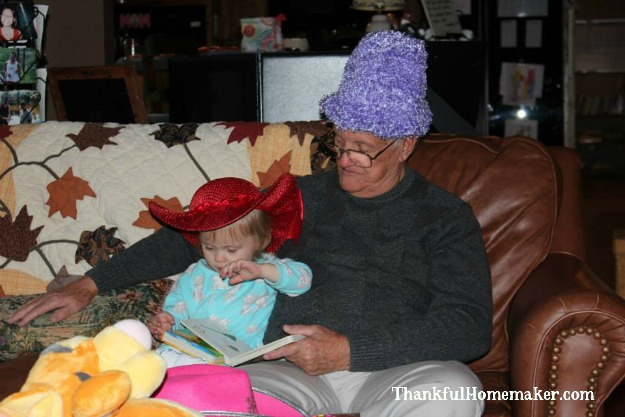 Our sweet Olivia with her Great-Grandpa. Grandpa loves those babies xoxo.